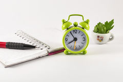 Alarm clock, open notebook and pencil on white background. Alarm clock, open notebook and pencil  on white background Stock Image
