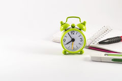 Alarm clock, open notebook, usb stick and pencil on white background. Alarm clock, open notebook, usb stick and pencil  on white background Stock Photo