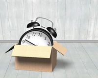 Alarm clock in opened cardboard box Royalty Free Stock Photo