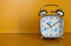 Alarm clock and orange background Royalty Free Stock Photography