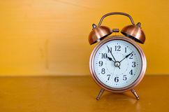 Alarm clock and orange background Stock Image
