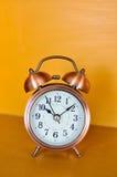 Alarm clock and orange background Royalty Free Stock Photo