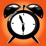 Alarm clock on the orange background Royalty Free Stock Photography