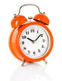 Alarm clock. Orange alarm clock isolated on white background Stock Image