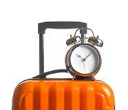 Alarm clock on orange suitcase Royalty Free Stock Image