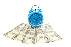Alarm clock over fan of money Stock Photography