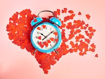 Alarm clock over the heart shape Royalty Free Stock Photos