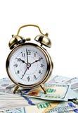 Alarm clock over money Stock Photography