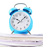 Alarm clock over the pile of papers Stock Photo