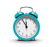 Alarm clock over white. Image of blue alarm clock over white Royalty Free Stock Images