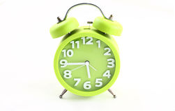 Alarm Clock. Pale green on a white background Stock Photography