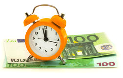 Alarm clock with paper money, 100 euro Royalty Free Stock Photo