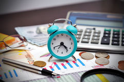 Alarm clock. Pen and calculator on table Royalty Free Stock Images