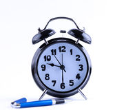 Alarm Clock  with pen closeup Stock Photos