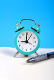 Alarm clock and pen Royalty Free Stock Image