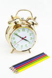 Alarm clock with pencils. Alarm clock with a pencil on a white background Royalty Free Stock Photography
