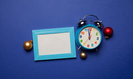 Alarm clock and photo frame Stock Images