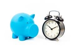 Alarm clock and piggy bank Stock Image