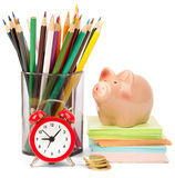 Alarm clock with piggy bank Stock Photography