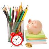 Alarm clock with piggy bank Royalty Free Stock Photos