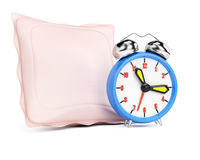 Alarm clock and pillow Stock Image