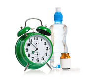 Alarm clock with pills Royalty Free Stock Photography