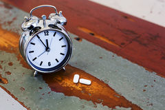 Alarm clock with pills Stock Image