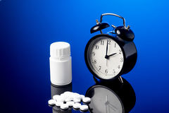 Alarm Clock and pills Royalty Free Stock Image