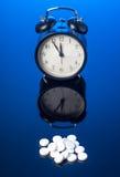 Alarm Clock and pills Royalty Free Stock Photos