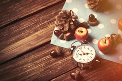 Alarm clock and pine cones Stock Photography