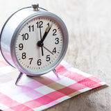 Alarm-clock on pink napkin Royalty Free Stock Images