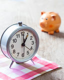 Alarm-clock on pink napkin Stock Photography
