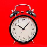 Alarm clock on red Royalty Free Stock Photo