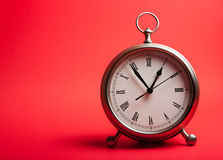 Alarm Clock on a red background Stock Photography