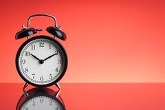 Alarm Clock on red background with selective focus and crop fragment. Business and Copy space concept royalty free stock photos