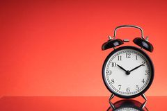 Alarm Clock on red background with selective focus and crop fragment. Business and Copy space concept royalty free stock images