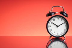 Alarm Clock on red background with selective focus and crop fragment. Business and Copy space concept royalty free stock photo
