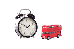 Alarm clock with red toy double decker bus Stock Photos