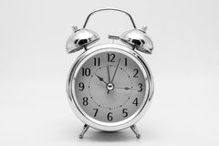 Alarm clock retro and vintage classic design on black and white. Background Stock Photo