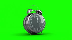 Alarm clock ringing on green background stock video