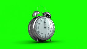 Alarm clock ringing on green background stock footage