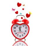 Alarm clock ringing with hearts and butterflies Royalty Free Stock Images