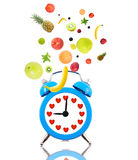 Alarm clock ringing,hearts and fruits Royalty Free Stock Photography