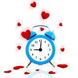 Alarm clock ringing with jumping hearts all around. Isolated Royalty Free Stock Photo