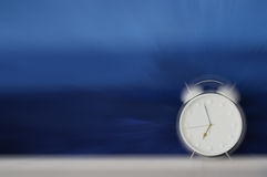 Alarm Clock Ringing Loud and Making Sound Waves - Motion Blur Royalty Free Stock Image