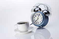 Alarm Clock. Ringing alarm clock and morning coffee on white background stock images