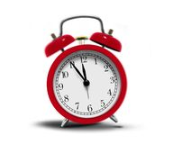 Alarm clock ringing. Red alarm clock ringing over white Royalty Free Stock Image