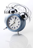 Alarm Clock. Ringing alarm clock on white background Royalty Free Stock Photography