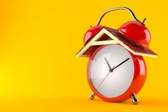 Alarm clock with roof. Isolated on orange background Stock Photos