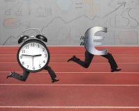 Alarm clock running after Euro money symbol Royalty Free Stock Image